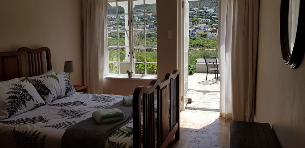 main bedroom, double bed, overlooking patio and mountain.