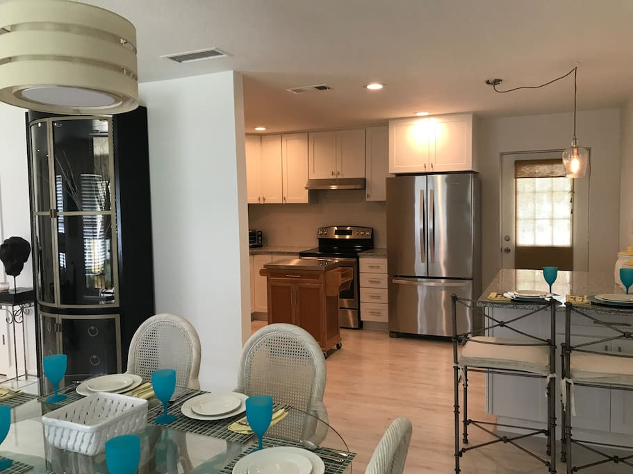 Dining room with stainless appliances