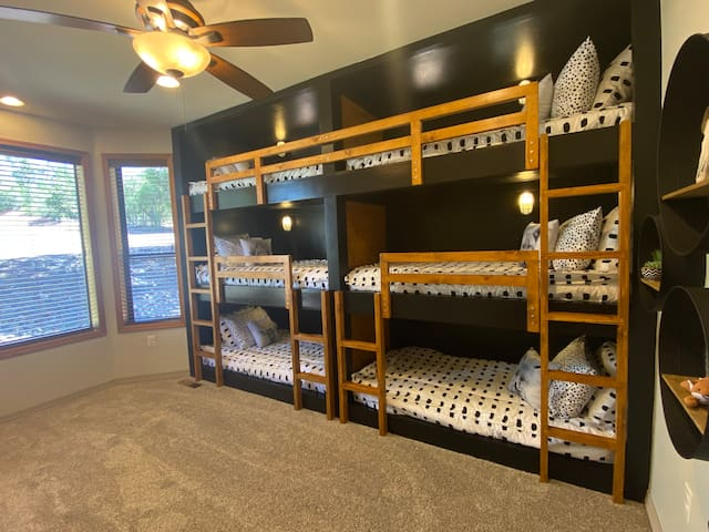 Magical childhood memories await! This bunk room accommodates 6 in cozy twin bed bunks.   *Please note: 3rd level is 6 feet high and for safety, only for ages 6 and up. Upper bunks constructed with specially treated timbers to accommodate 225 lbs.