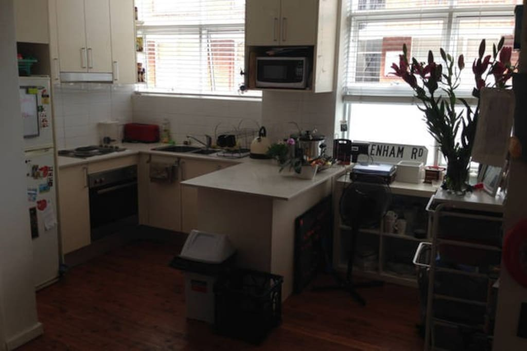 Kitchen/Living Space. Oven, stovetop, fridge (with space for you!). All cups/plates condiments etc are for your use.