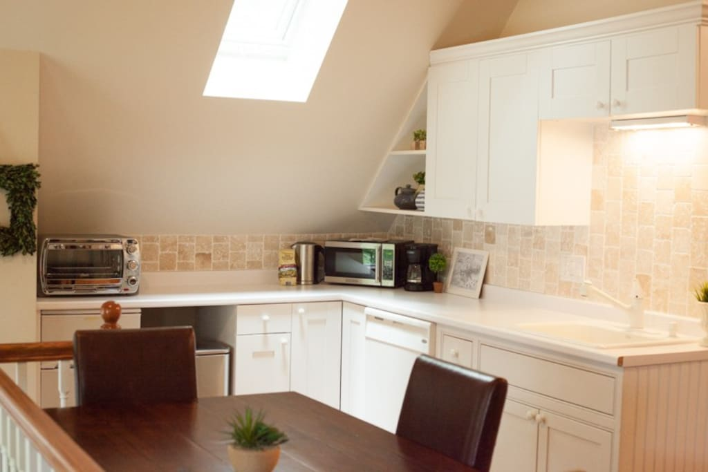 kitchen includes, toaster oven, microwave, coffee maker, hot water boiler etc.