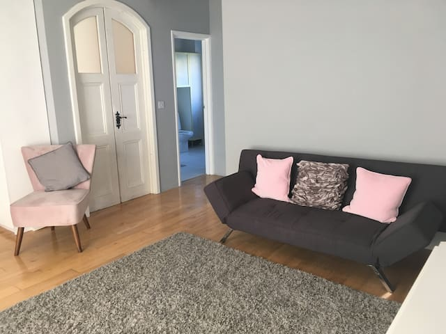 Main living space with small double sofa bed