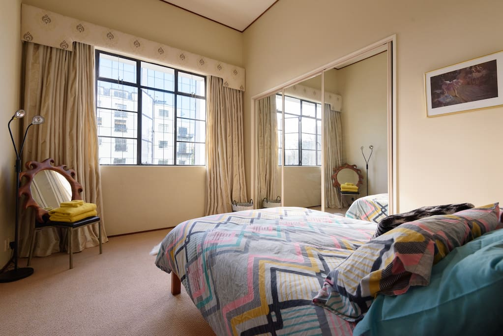 Your room is spacious and welcoming, with further views of Auckland City and Myers Park.