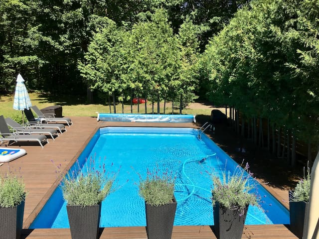 The backyard pool is heated. Lounge on the spacious deck with lavendar plants providing a relaxing scent, and enjoy the outdoor SONOS music system to complete your amazing day