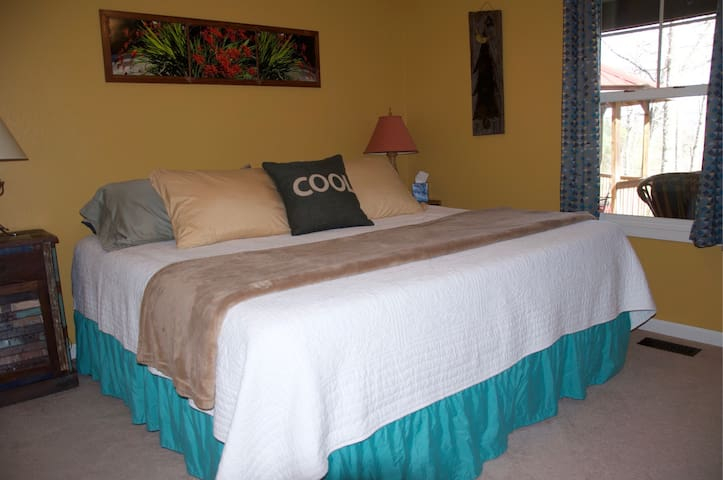 Second bedroom has tempurpedic king size bed with massage feature