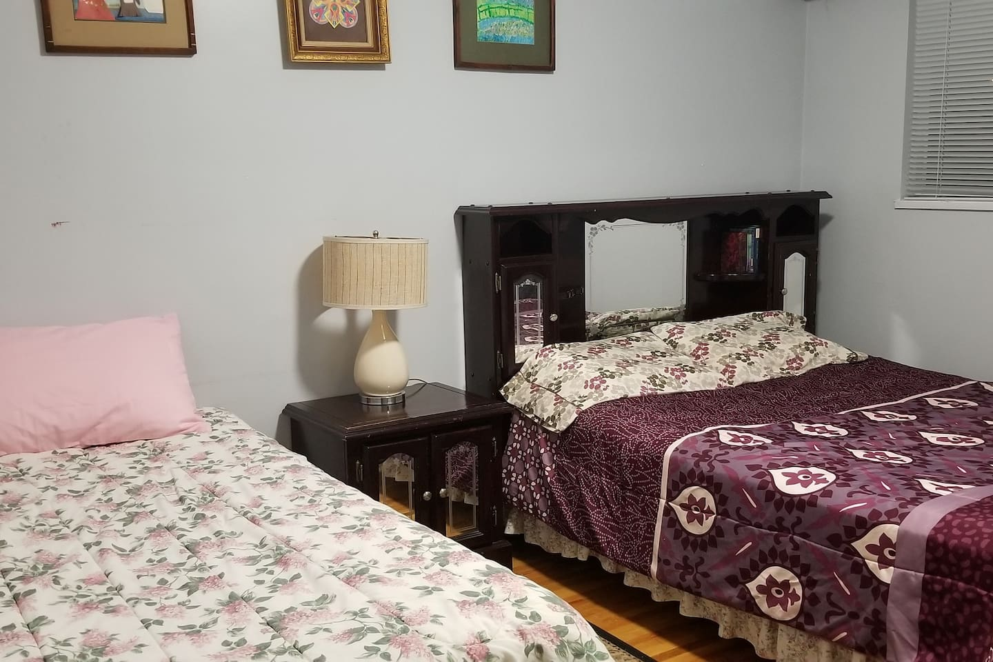 A Queen bed and a Twin bed.