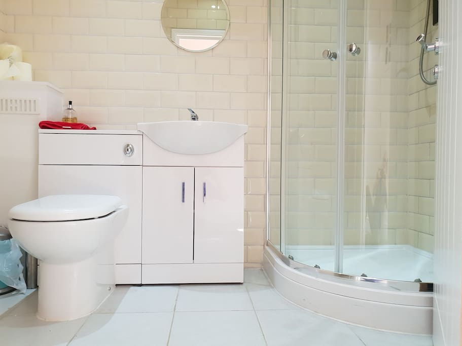 Modern, clean, stylish bathroom with effective shower, soaps and gels.