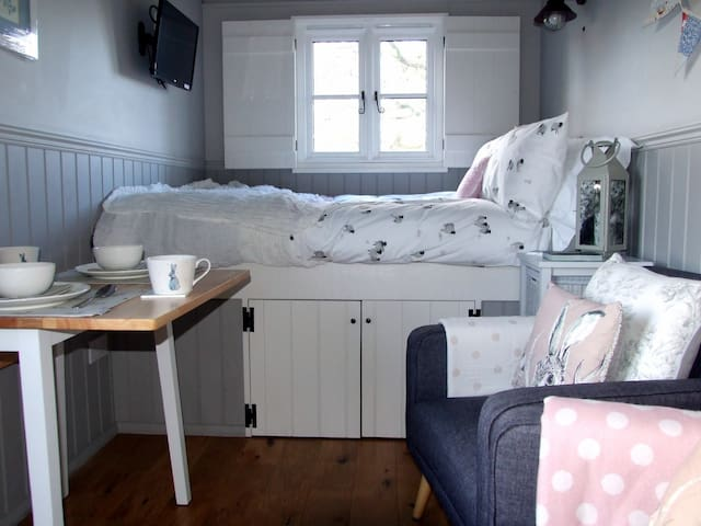 Comfy bed with luxury bedding and living space