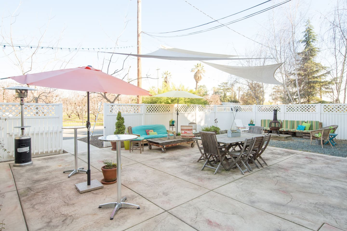 Outdoor common area with firepit, bar-b-cue, fountain, pond and lounge.