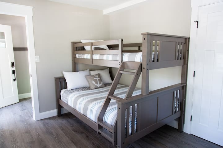 Bedroom 4: Twin over full bunk bed with closet and dresser. Stacked washer/dryer and vacuum are also located in the closet.
