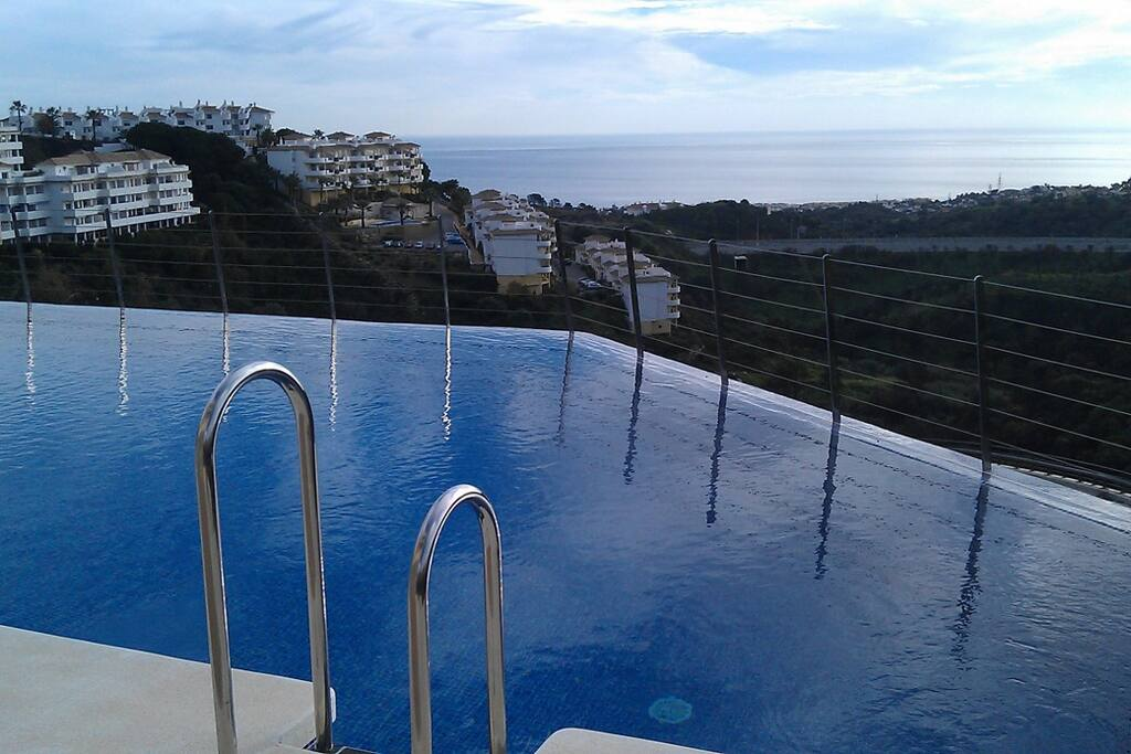 Infinity pool with ocean view at the apartment building.