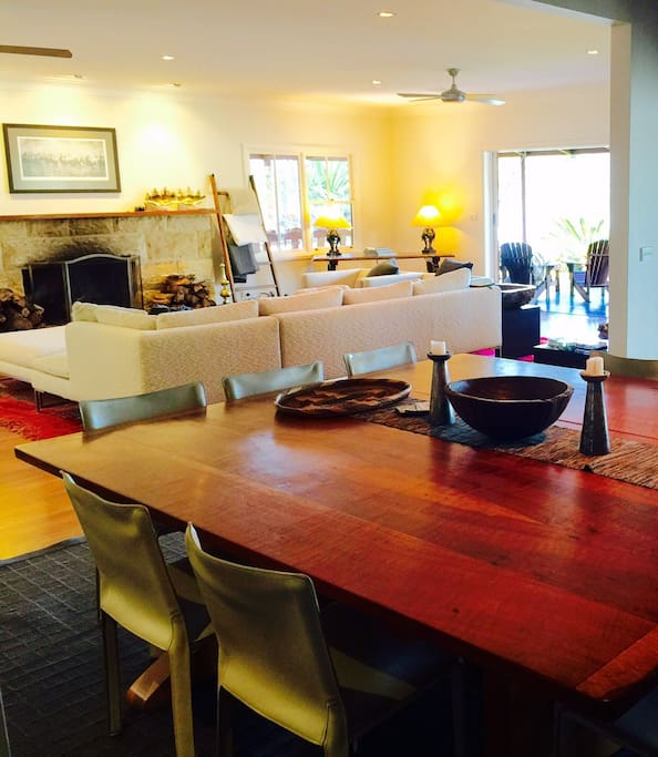 Open plan living so the indoor dining flows effortlessly into the  lounge, with the huge chef's kitchen open onto both