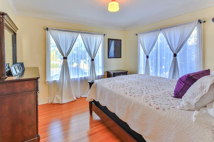 Olympic Homestay: North Guest Room features queen memory foam bed, dresser, desk, closet, radiant heater, and plenty of natural light.