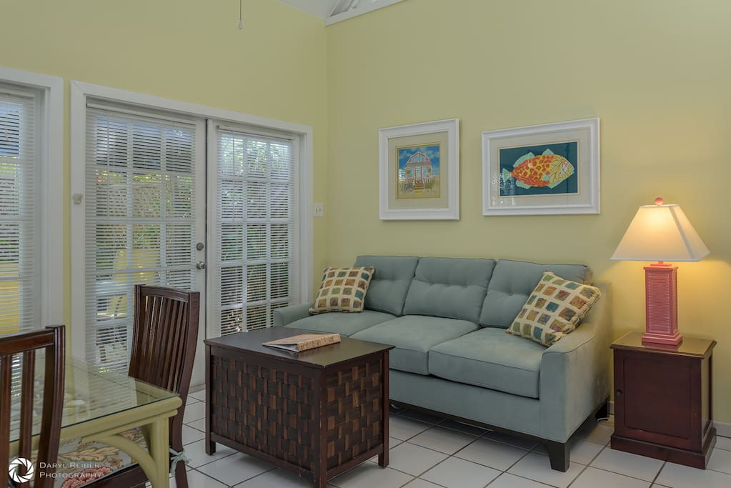 Living room with sleeper sofa and french doors to private deck