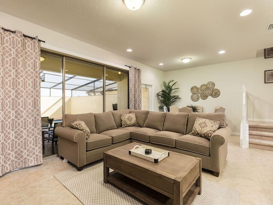 Relax in the living area with easy access to the pool deck