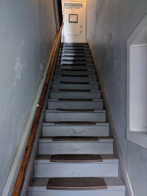 The apartment is upstairs