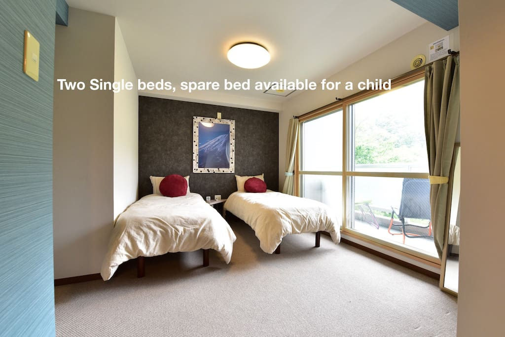 Two single beds with a spare cot for children