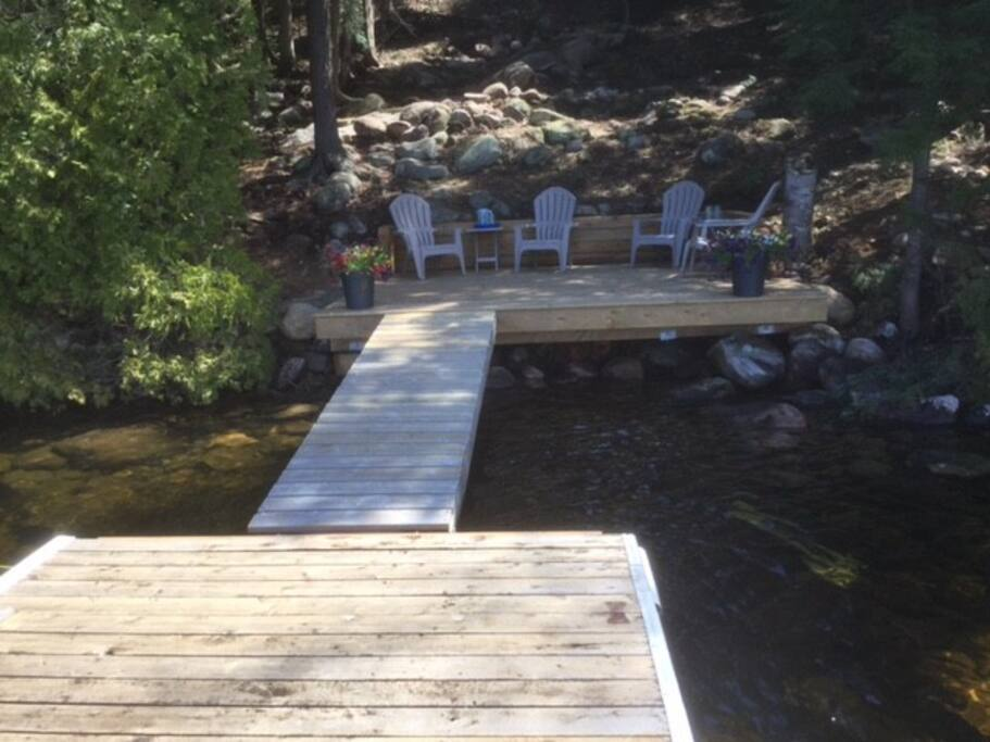 Dock and deck with plenty of sun and shade for your lakeside pleasure