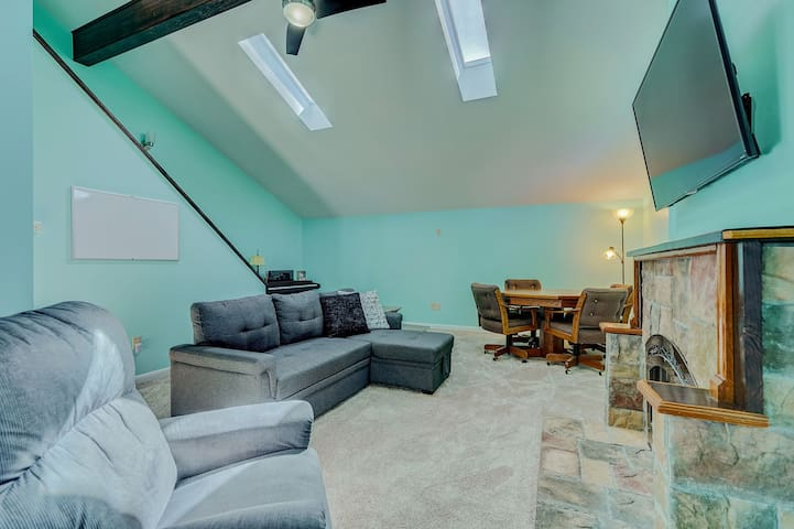 Comfortable family room off the entry, with a convertible sofa accommodating additional overnight guests