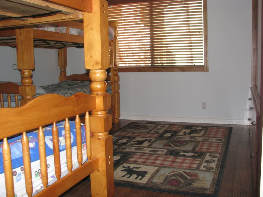 """Kids will love the """"bunk room"""".  One of the bunks has a trundle underneath.  There is a pack and play in the closet.  Trains and legos to play with in the closet too."""