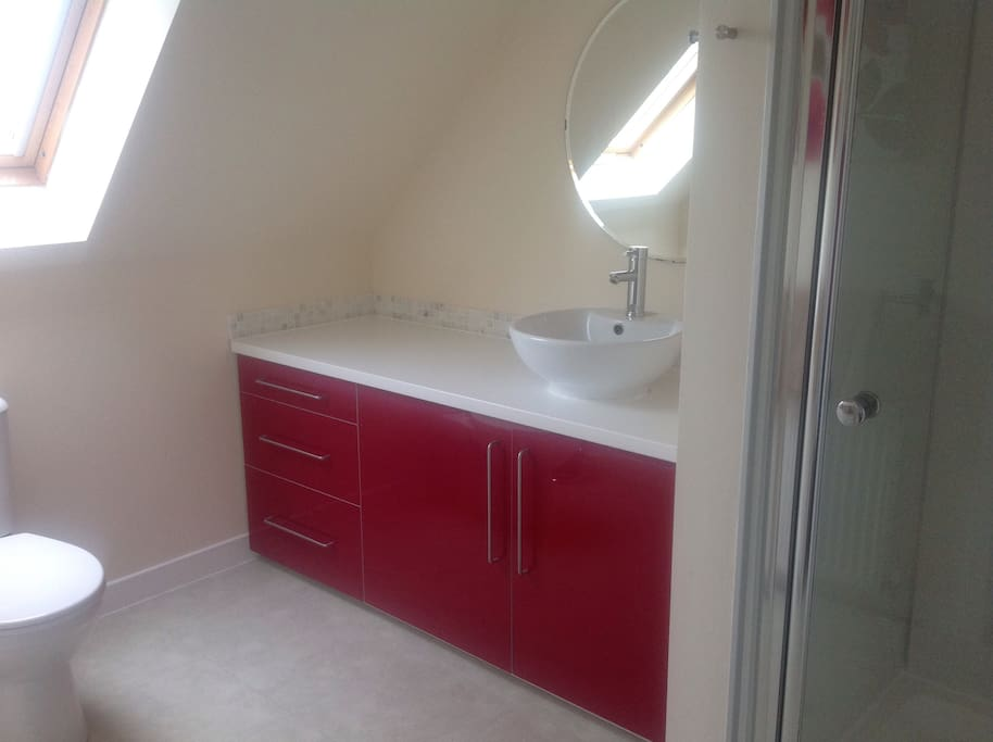 Spacious ensuite with power shower and views over the fields and beyond