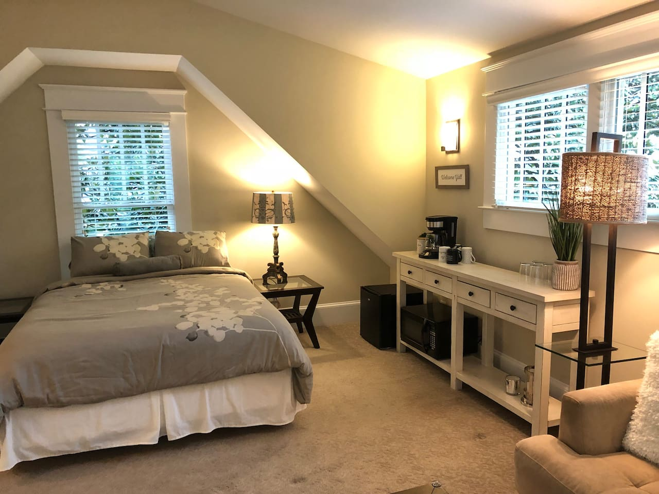 Queen bed. Kitchenette with microwave, mini fridge, bowls, plates, paper towels, and silverware. Coffee, creamer and cups provided.