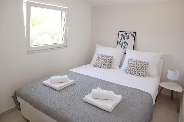 Bedroom 1 with 2 beds- first floor apartman