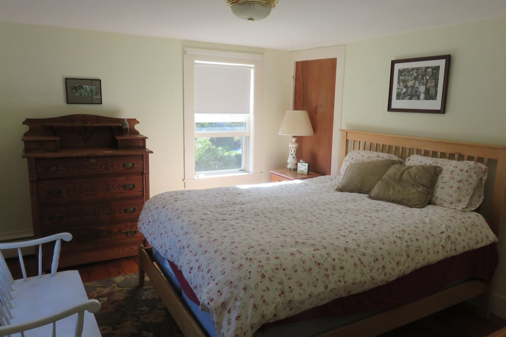 Gloucester Room (features photos)  queen size bed, antique dresser and chest.   Afternoon sun