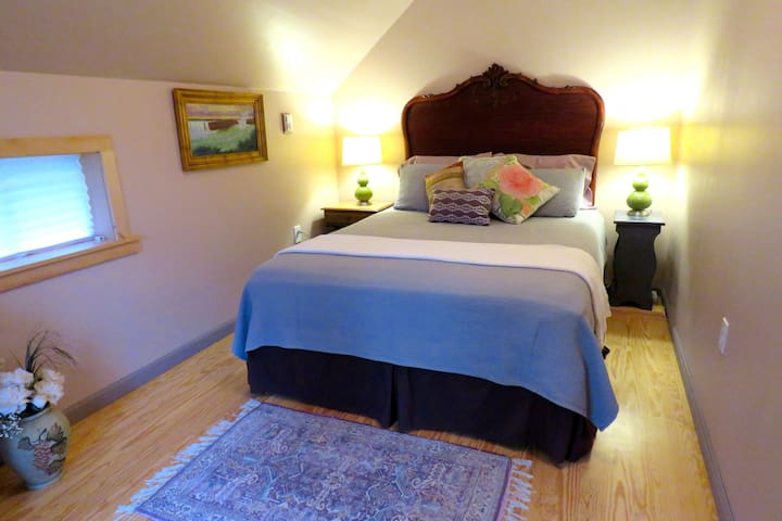 Your eclectic bedroom with comfy queen bed
