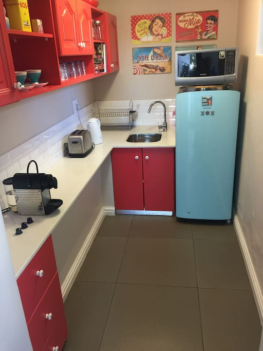 Kitchen with microwave , fridge , toaster and nespresso  machine .