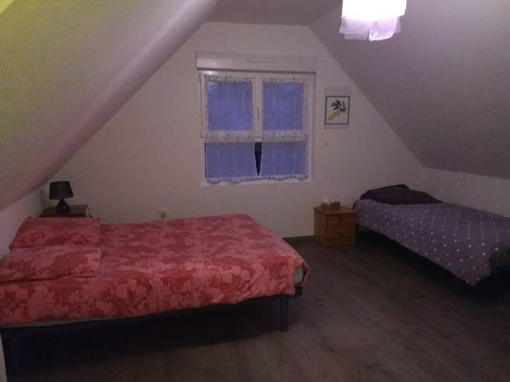Chambre simple et conviviale chez l'habitant
