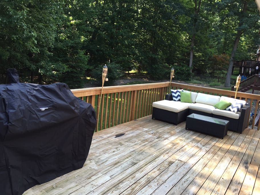 Back deck features grill/smoker and sectional - with room to spare.