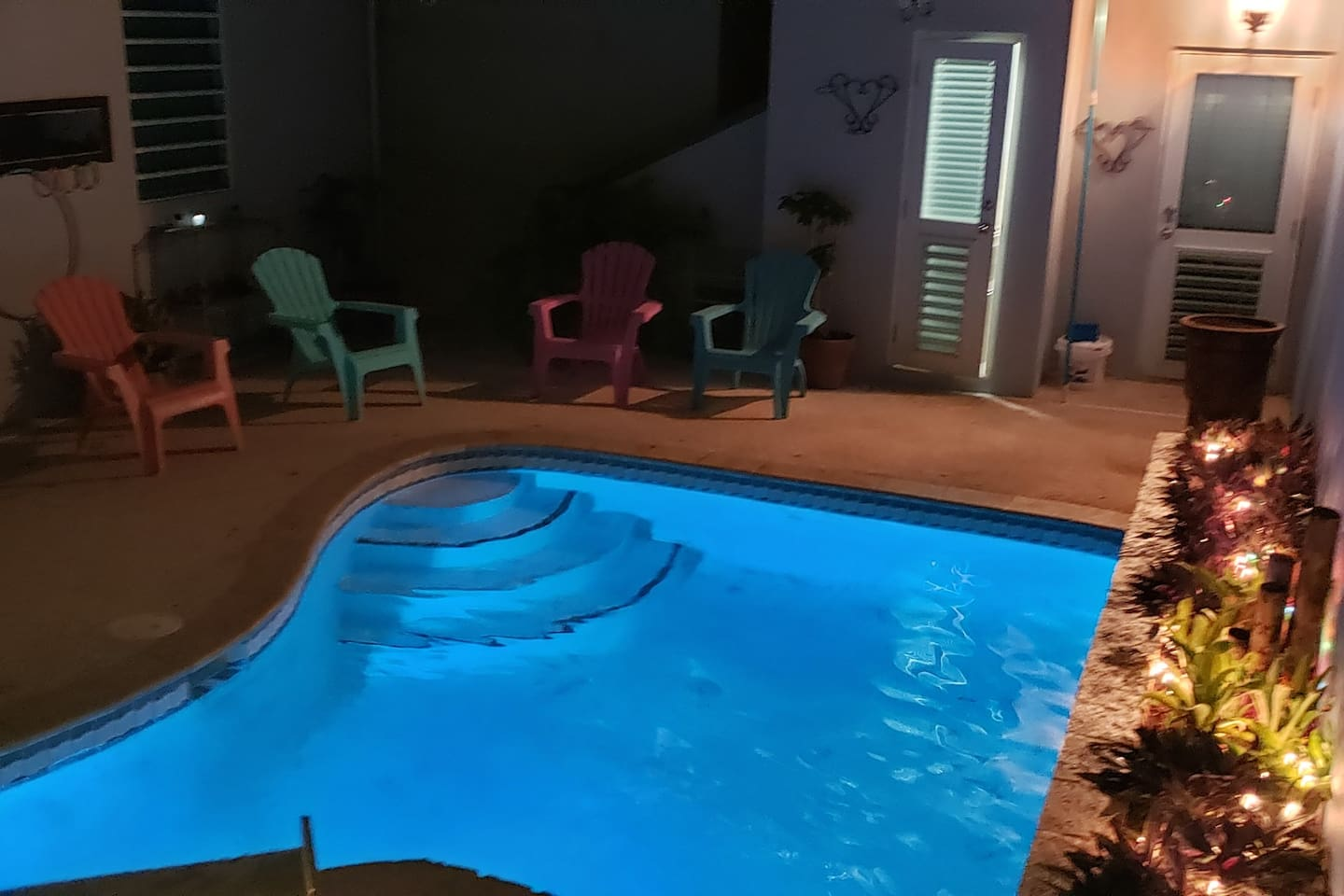 The pool at night with fun lights.