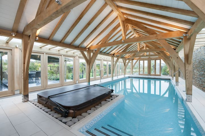 A luxury barn conversion with lavish indoor heated pool, hot tub, steam room & gym