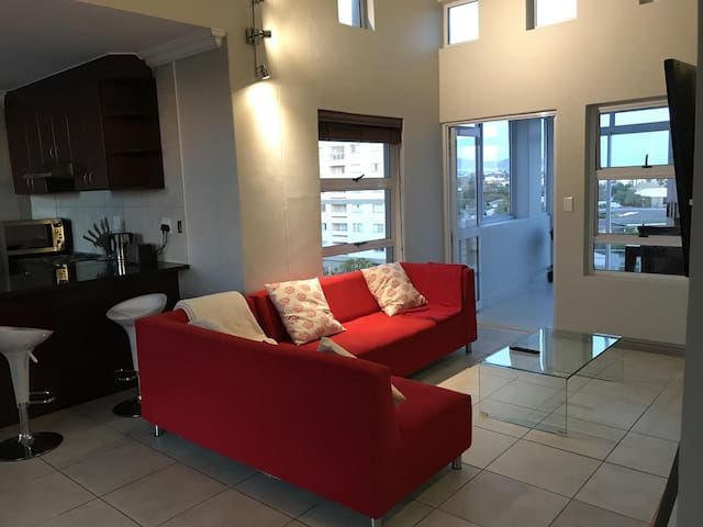 The lounge has a six seater couch and views of table mountain.