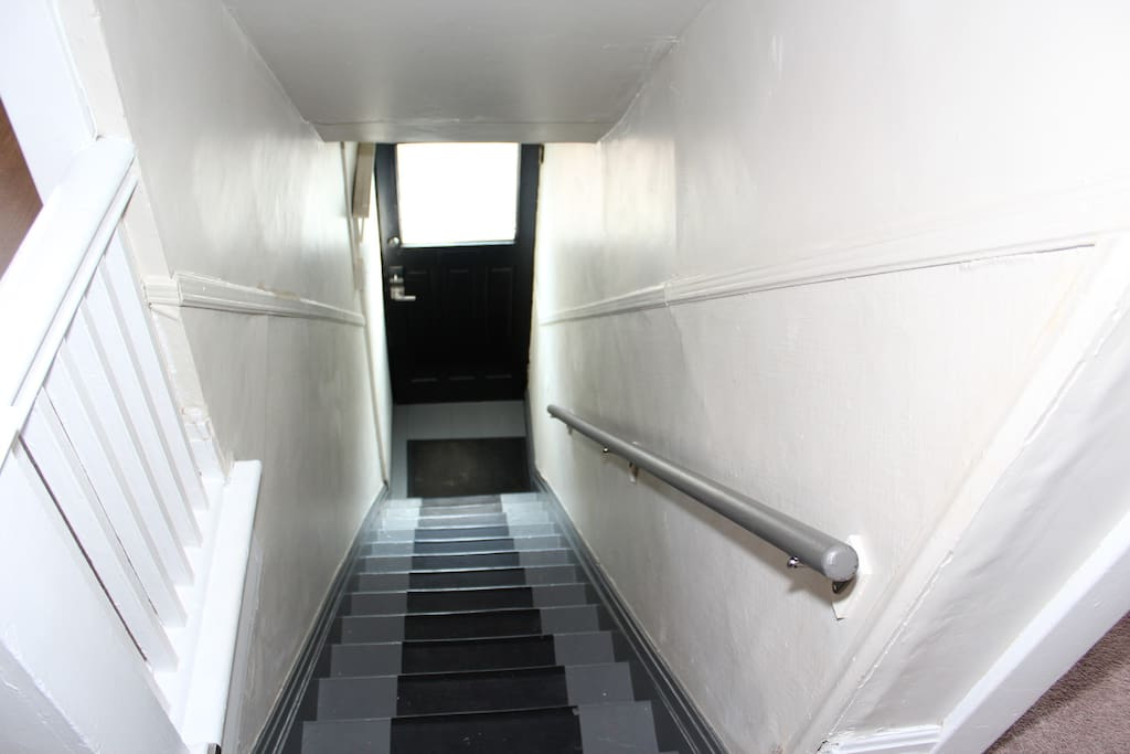 Private entrance and stairs up to the second floor apartment