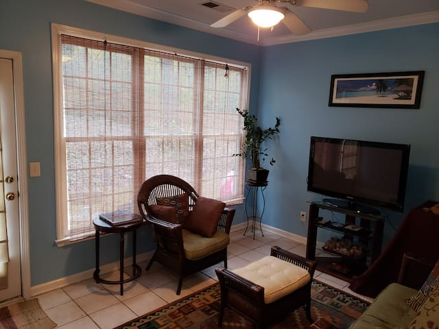 Enjoy and chill in the sunroom, next to the kitchen. P.S. TV (without cable) and DVD player.