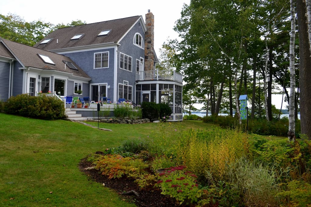 The home's spacious grounds feature gardens and lawns for croquet.