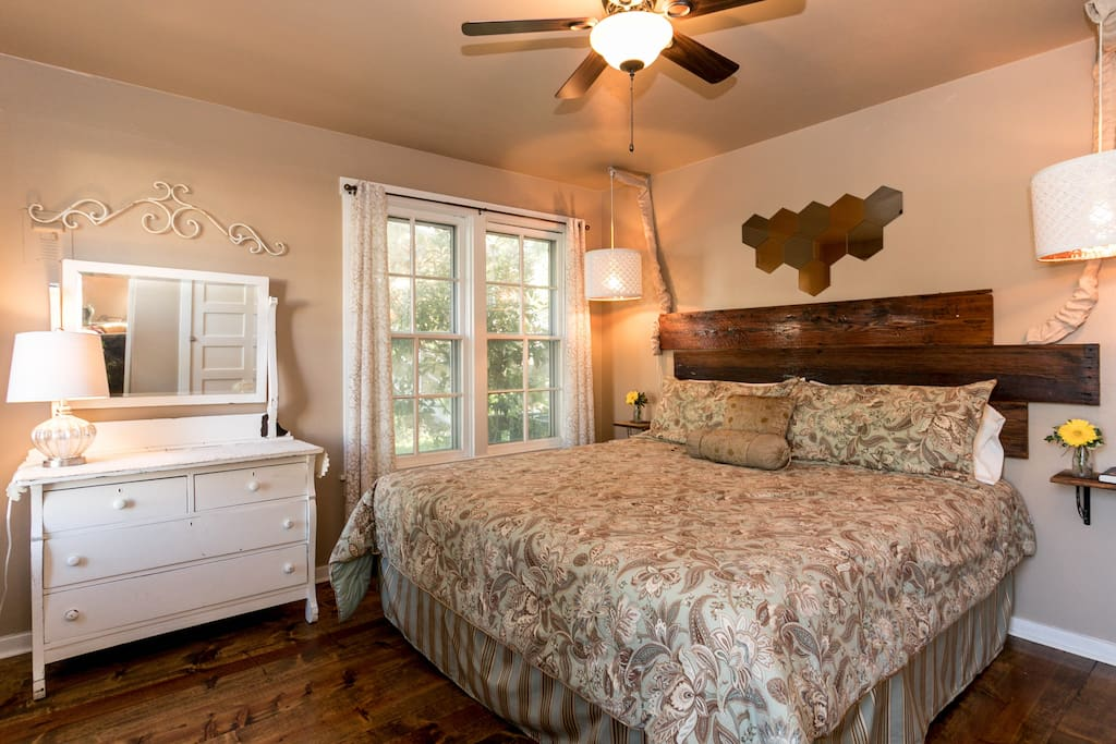 Beautiful bedroom featuring a king size bed and reclaimed wood floor