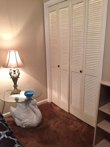 Large closet with double hung rods and storage shelves