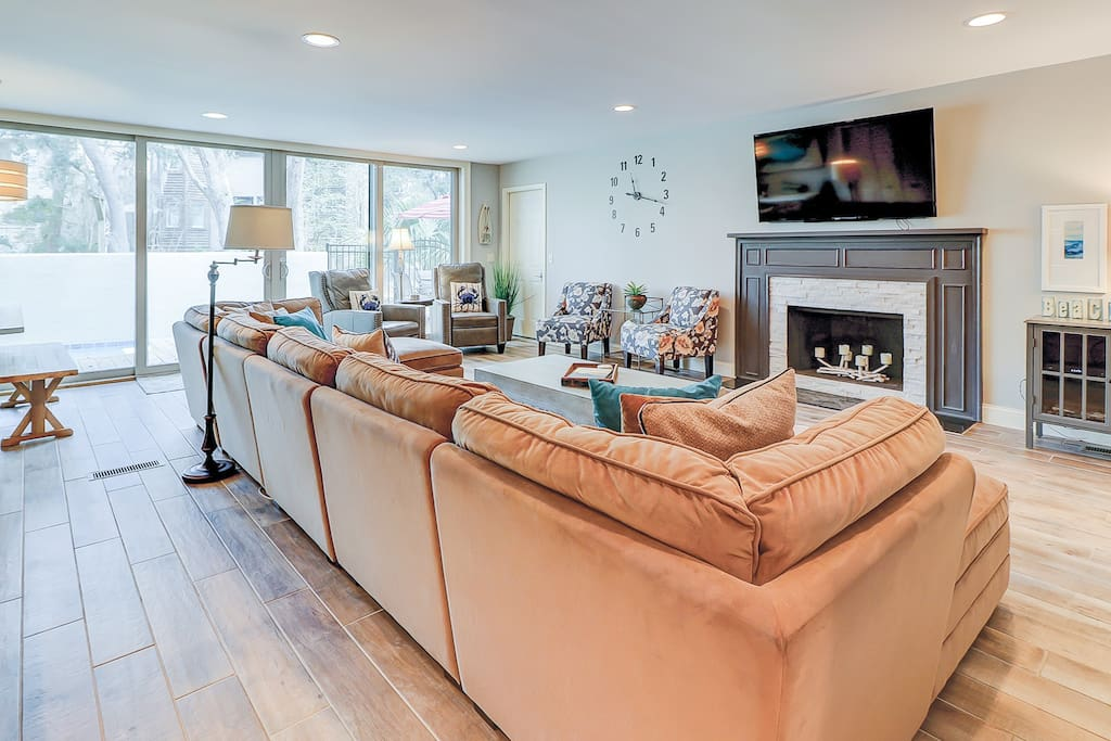 Spend quality time together in the 1st-floor living room with chic decor and plenty of comfortable seating.
