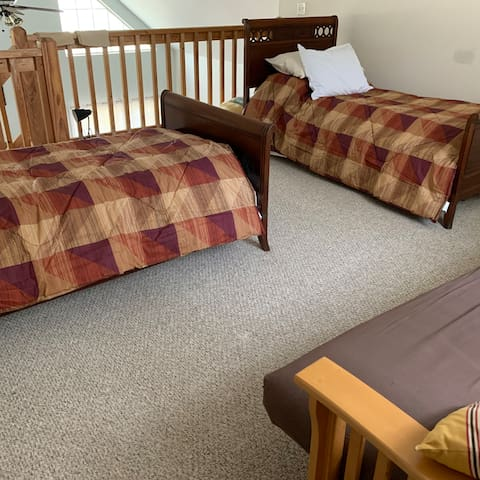 """Loft contains two twin beds, a futon, and 2 twin """"bed chairs"""" for sleeping.  The loft can also be used to play games or hook up electronics."""
