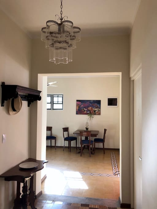 Inside hallway and view of dining space.
