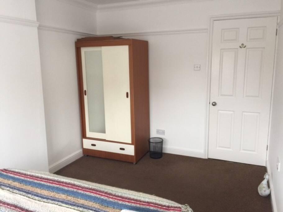 Single wardrobe with full length mirror.