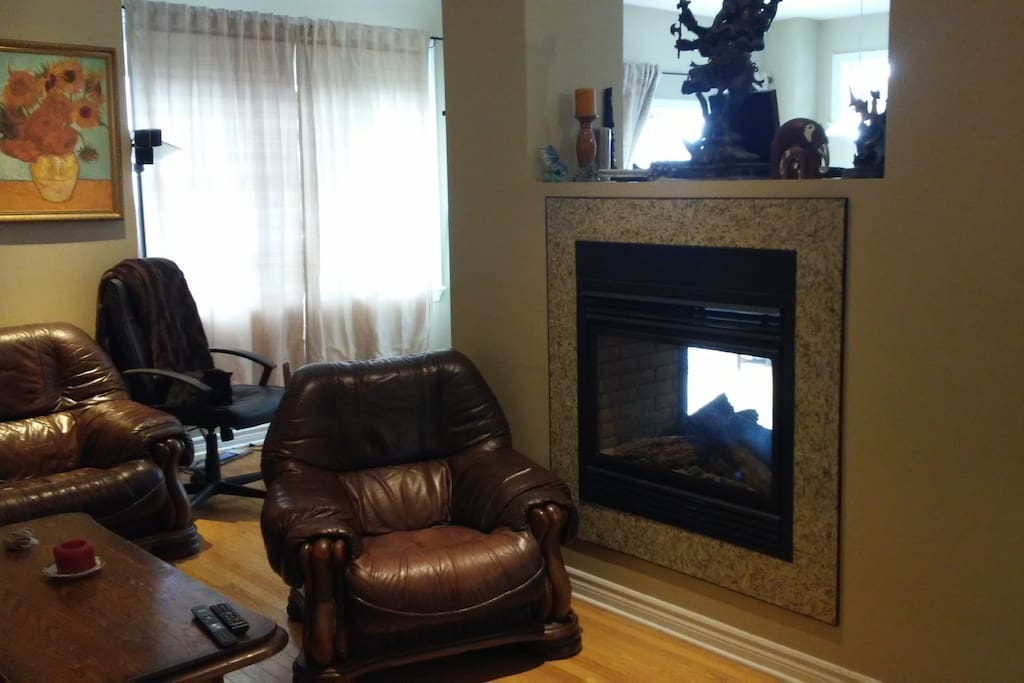 comfy leather chairs; two-way fireplace