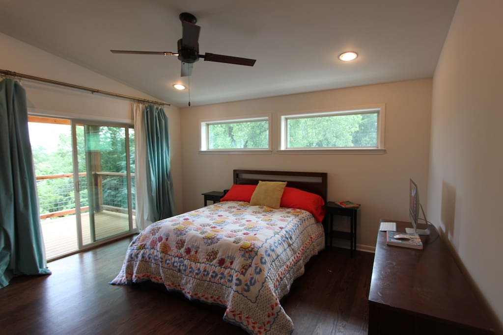 Master bedroom with deck access and queen size bed
