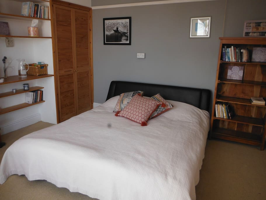Comfortable king-sized bed in large room enjoying the morning sun !  (can be made up as two singles on request).