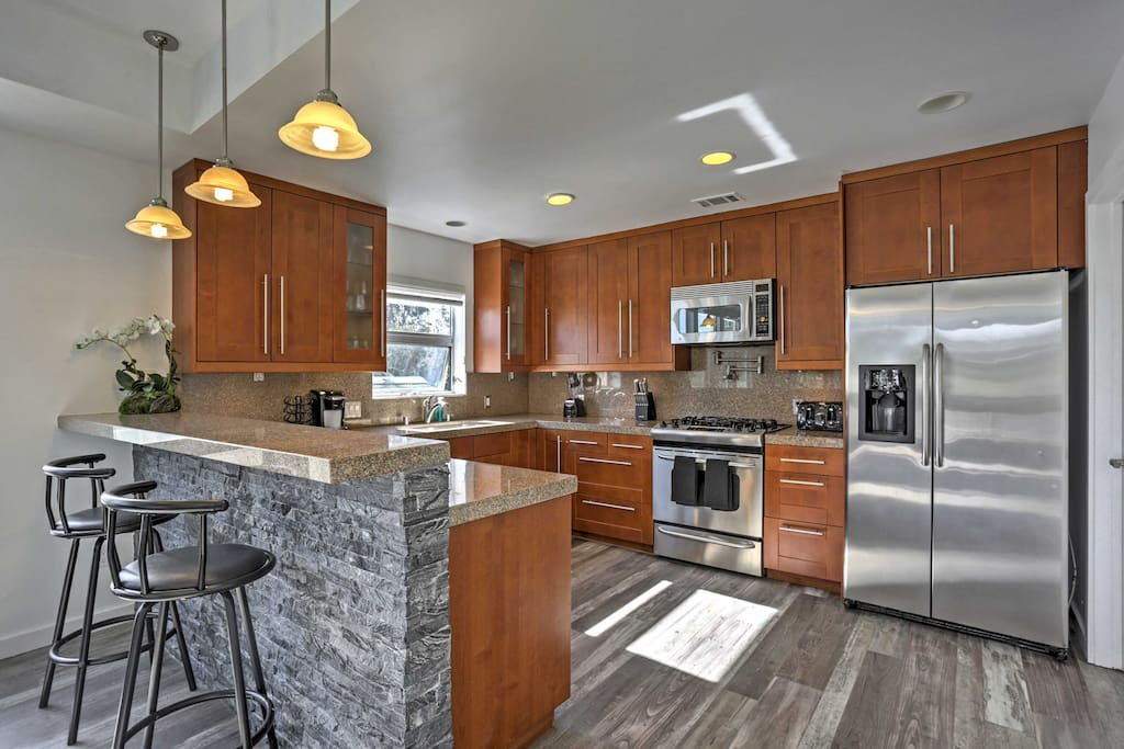 Bring all your favorite recipes to life in the fully equipped kitchen, featuring top-of-the-line stainless steel appliances.
