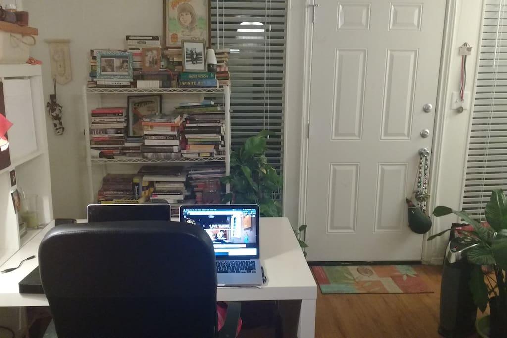 Desk, bookshelf and door leading to patio.