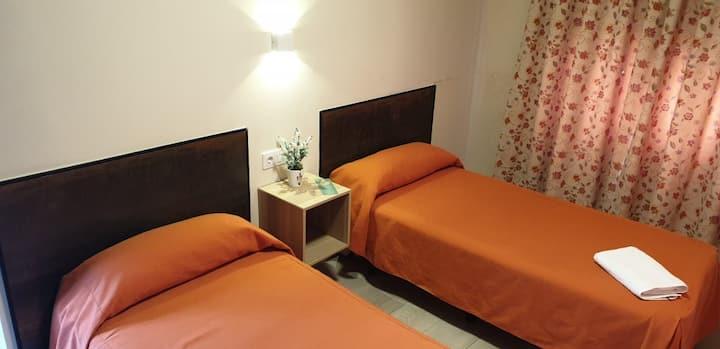 Habitación doble 2 camas con baño privado